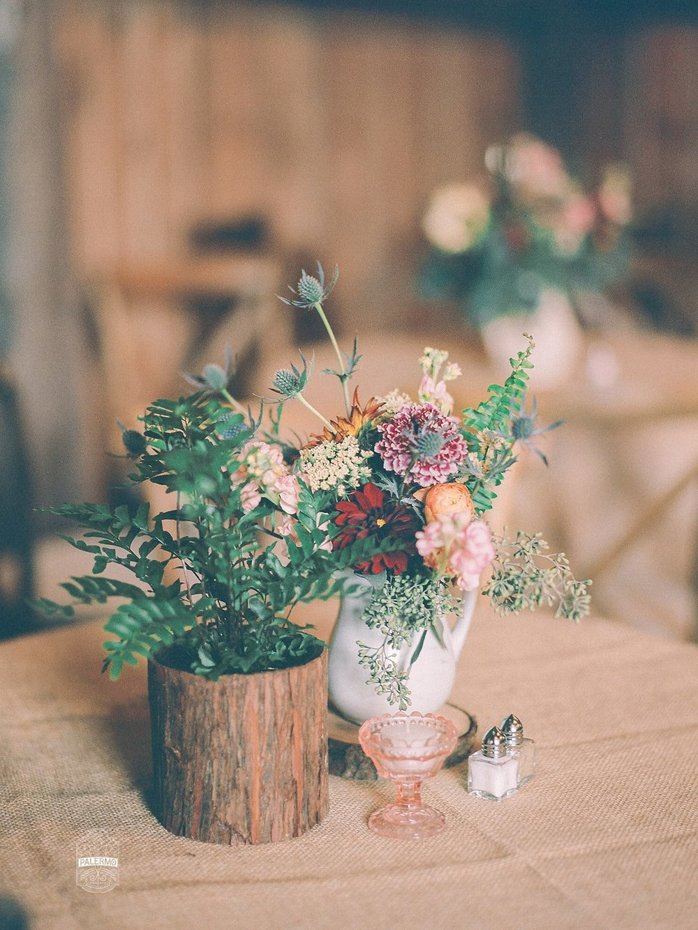 Wedding centerpieces and table settings for rustic fall barn wedding in Pittsburgh, PA planned by Exhale Events. Find more wedding inspiration at exhale-events.com!