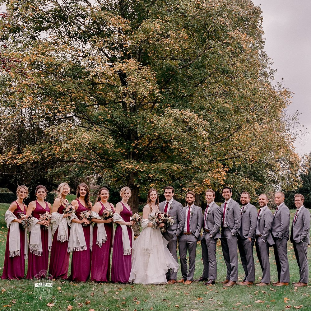 Wedding party poses for wedding photos with for burgundy fall barn wedding in Pittsburgh, PA planned by Exhale Events. Find more wedding inspiration at exhale-events.com!