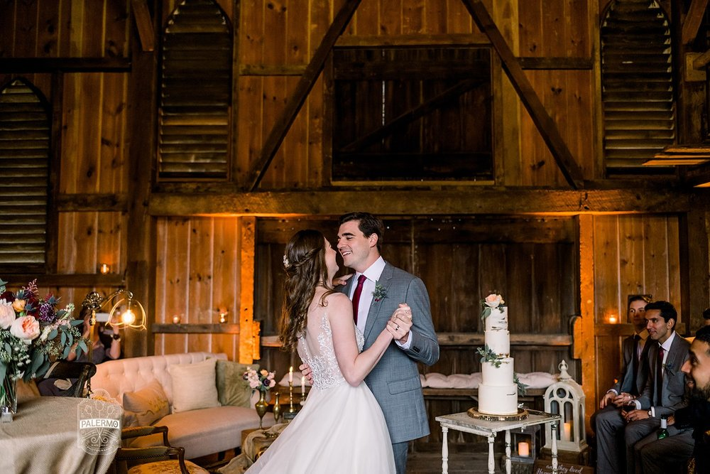 Bride and groom share a first dance at fall barn wedding in Pittsburgh, PA planned by Exhale Events. Find more wedding inspiration at exhale-events.com!