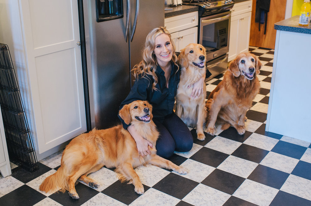 Bride getting ready with her dogs for black, white, and gold wedding in Buffalo, NY planned by Exhale Events. Find more wedding inspiration at exhale-events.com!