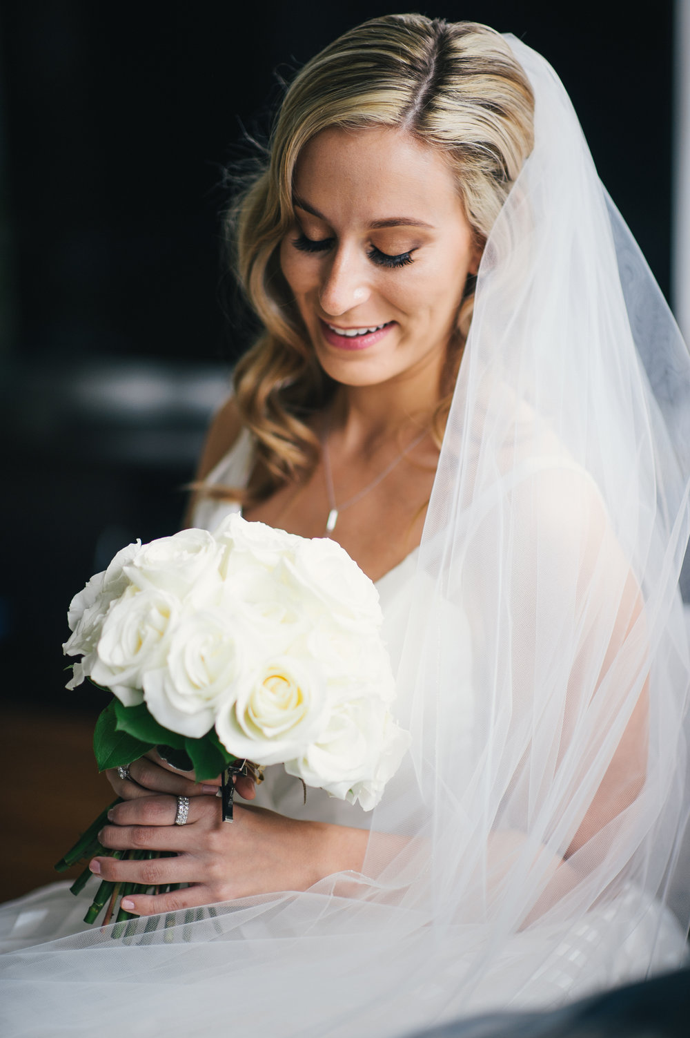 Bride posing for wedding photos in wedding dress with wedding bouquet for black, white, and gold wedding in Buffalo, NY planned by Exhale Events. Find more wedding inspiration at exhale-events.com!
