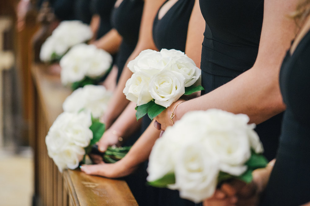 White wedding bouquets for black, white, and gold wedding in Buffalo, NY planned by Exhale Events. Find more wedding inspiration at exhale-events.com!