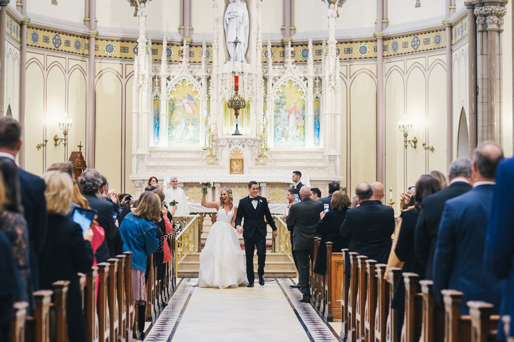 Bride and groom at their wedding ceremony for black, white, and gold wedding in Buffalo, NY planned by Exhale Events. Find more wedding inspiration at exhale-events.com!