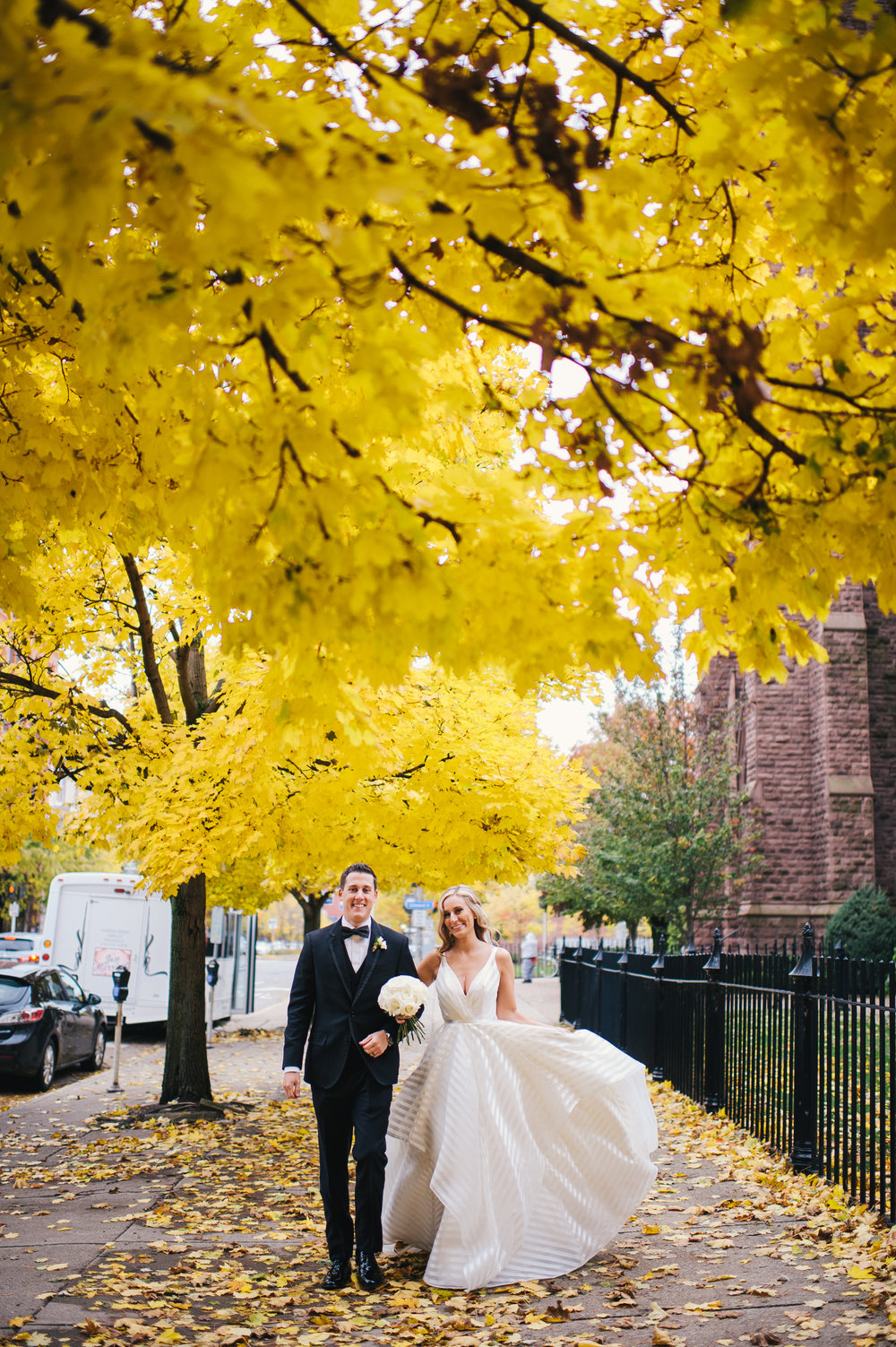 Bride and groom pose for outdoor wedding photos for black, white, and gold wedding in Buffalo, NY planned by Exhale Events. Find more wedding inspiration at exhale-events.com!