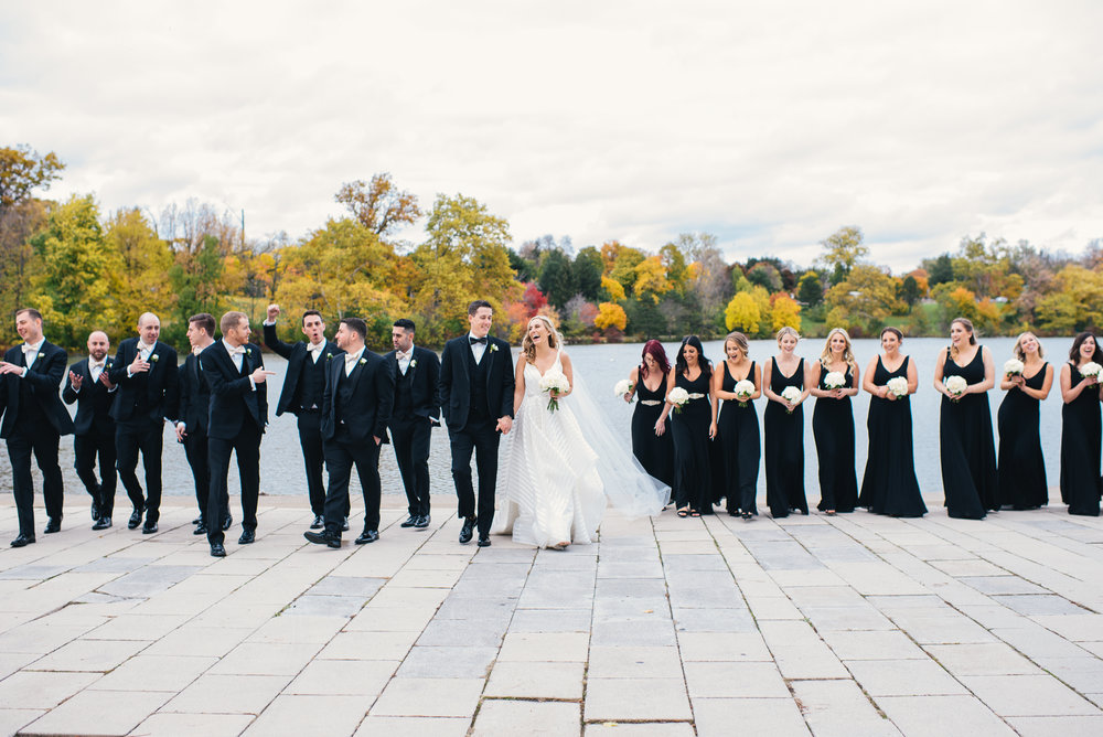 Bride and groom pose for outdoor wedding photos with wedding party for black, white, and gold wedding in Buffalo, NY planned by Exhale Events. Find more wedding inspiration at exhale-events.com!