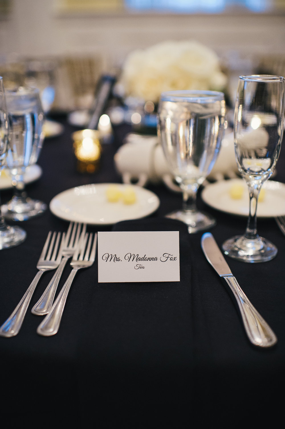 Black and white wedding table decor with wedding escort card for black, white, and gold wedding in Buffalo, NY planned by Exhale Events. Find more wedding inspiration at exhale-events.com!
