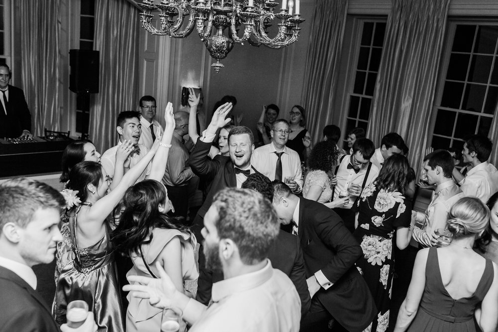 Even in a tight space, having a speaker system that fits the room and a black wrap-around that covers the DJ console makes a huge difference.   Photo Elizabeth in Love .   Graydon Hall Manor.