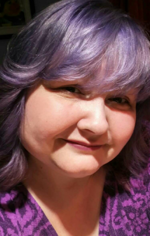 I treated myself to purple hair when I turned 50!
