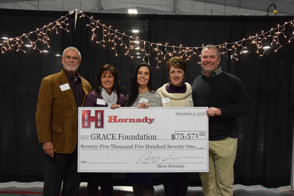 "Thank you, Hornady! - $75,571 donated in 2016Hornady® Manufacturing has donated a generous gift to The GRACE Foundation during their annual Christmas party. This is the 4th year The GRACE Foundation has received this gift.The donation was made possible from partial proceeds of the sale of Hornady® Critical Defense® Lite™ ammunition sold from November 2015 through November 2016. Critical Defense® Lite™ features a pink bullet tip and pink ribbon packaging to help showcase support in the fight against cancer.Laurie Kulus, Executive Director of GRACE Foundation adds, ""This gift makes it possible for us to directly affect families in our community and the surrounding area. Hornady is extremely dedicated to our community and this gift is a direct reflection of their commitment. We areblessed beyond words for this incredible donation and thank Hornady for being an outstanding community advocate. Without this gift, we would not be able to help assist as many cancer patients as we are able to because of this."
