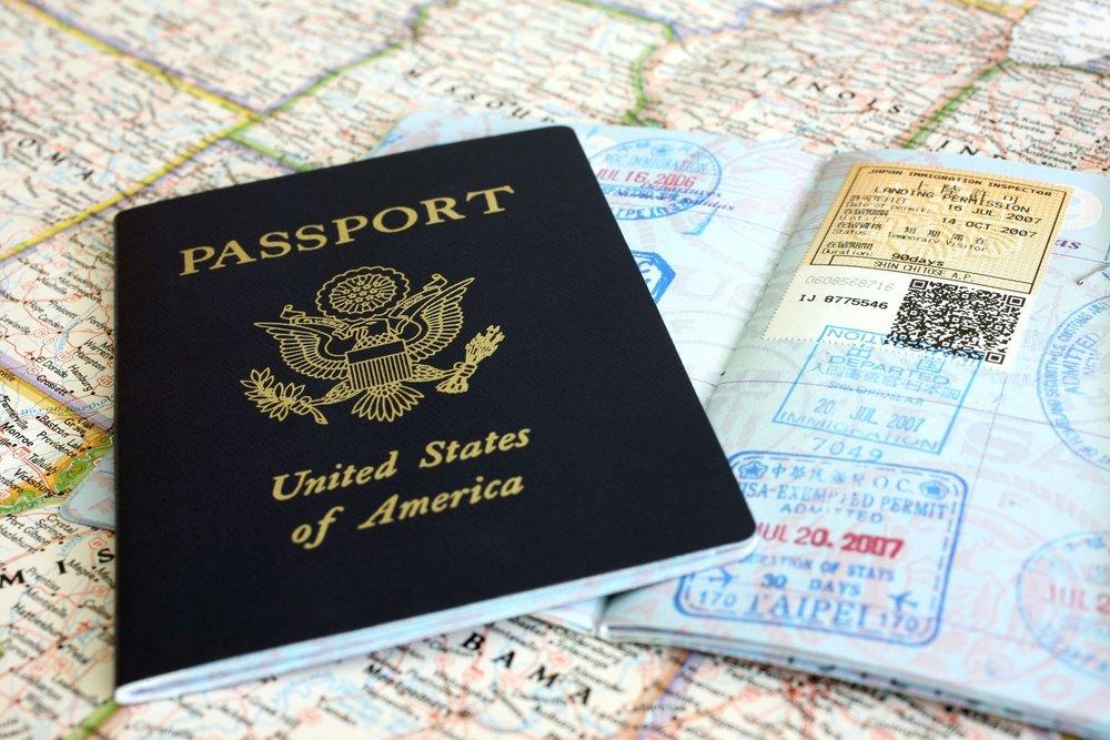 american-passport-and-map-579e3f333df78c327670e17e.jpg