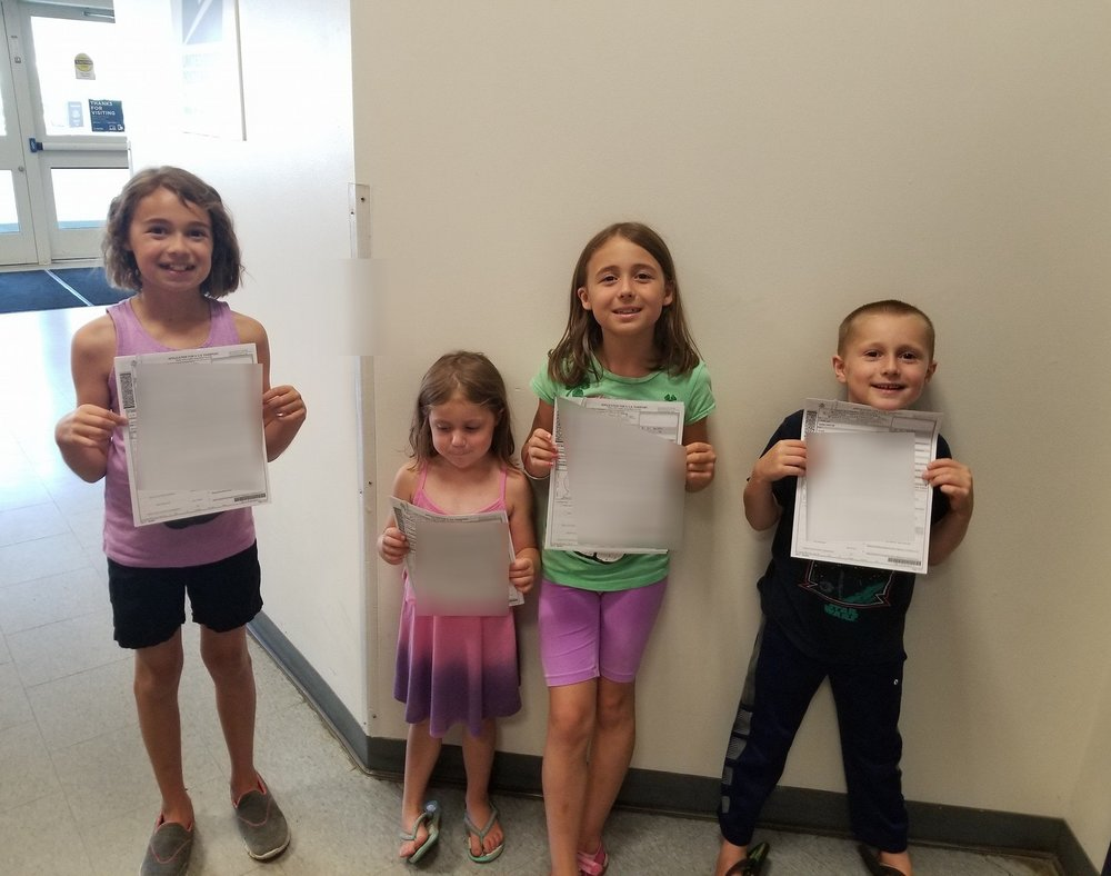 My kids with their passport applications! Applying at the Post Office is super quick and easy.. even with 4 kids!