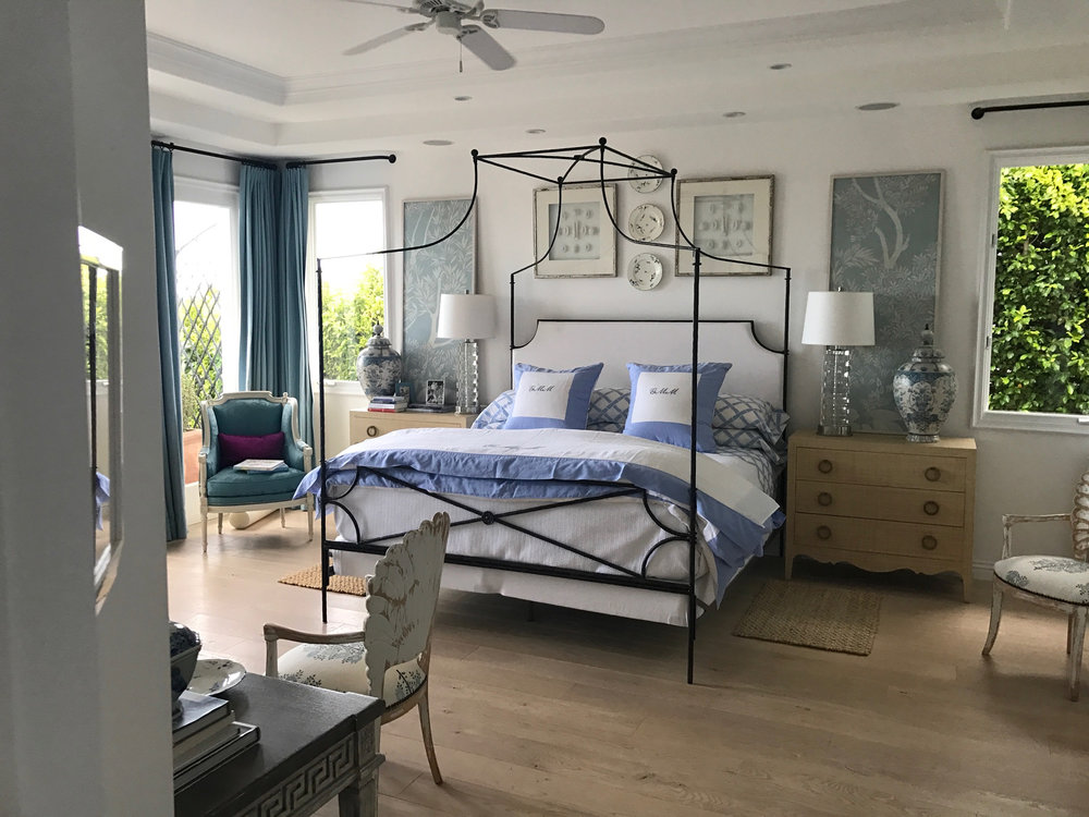 Master bedroom in French style home in California, wood floors, high ceilings, canopy bed.