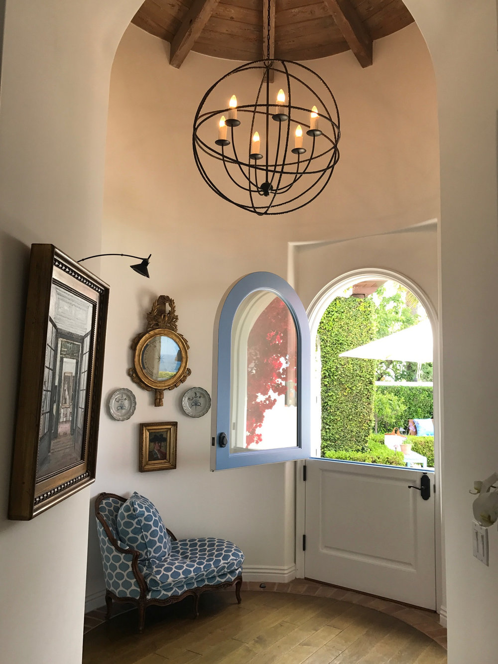 Laguna Beach home with Dutch door in French Blue, wood floors and wood ceilings.