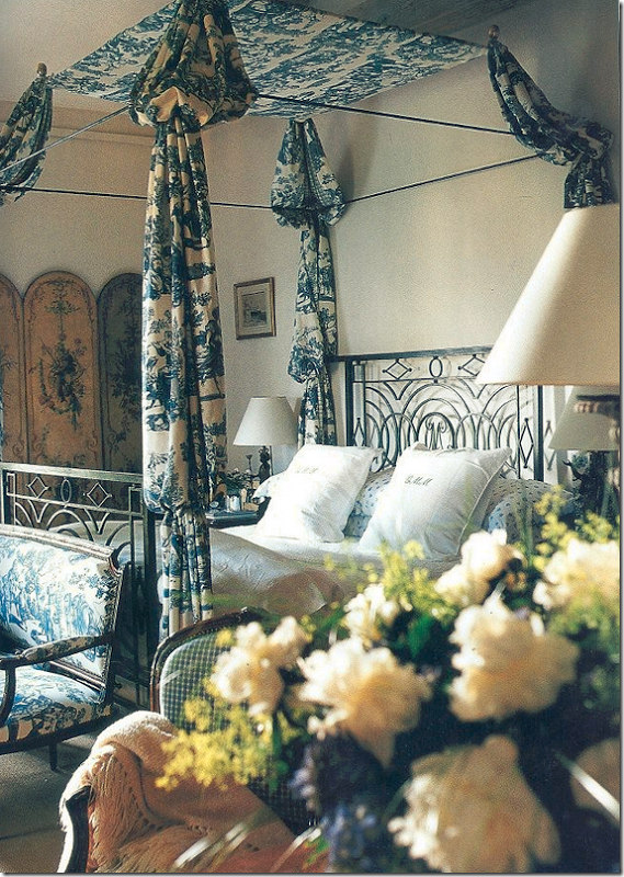 French bedroom design by Ginny Magher with flowers and toile bedspread.