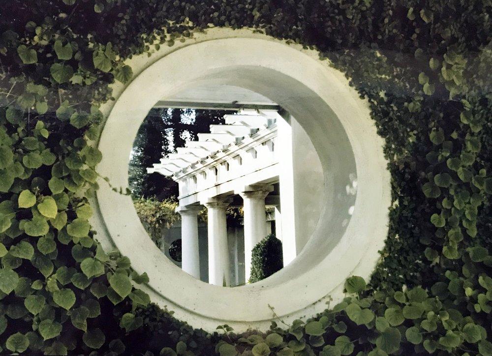 Circular window detail in Parisian design home