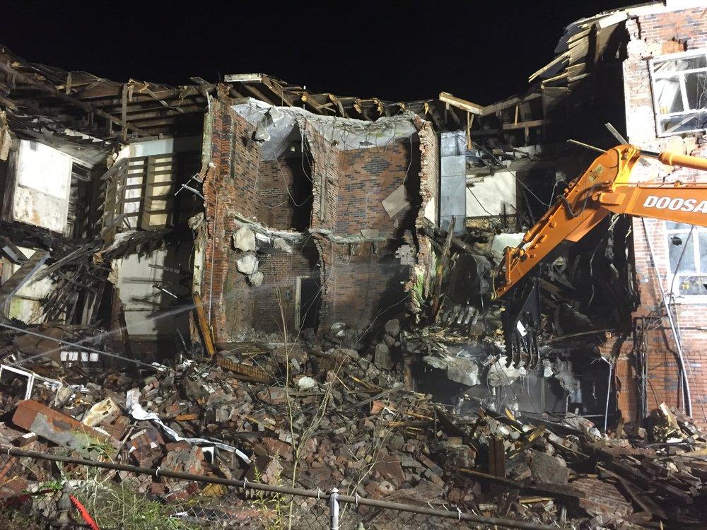 Commercial building demolition with asbestos abatement (wet demolition)