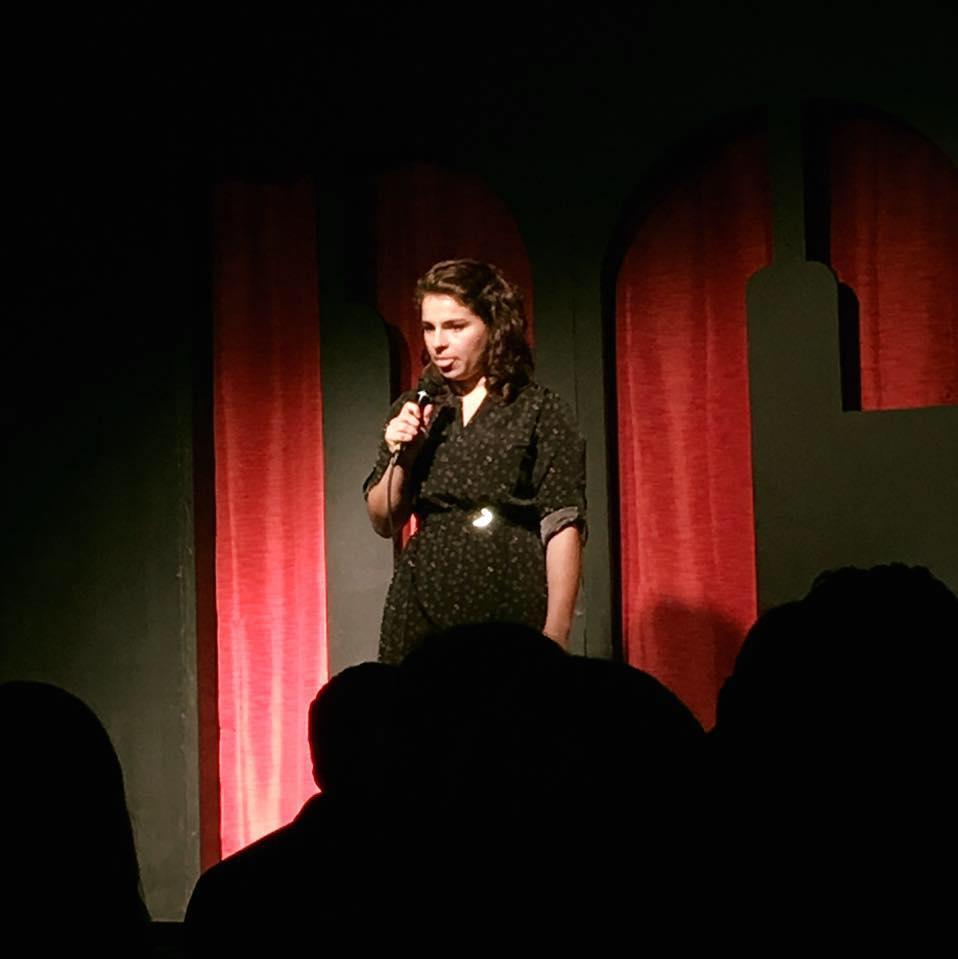 Devon Kodzis telling a story onstage.