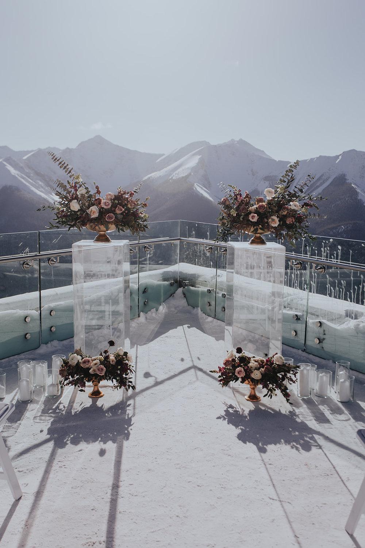 Outdoor winter wedding at Sky Bistro Banff, Flowers by Janie, pedestals of flowers.jpg