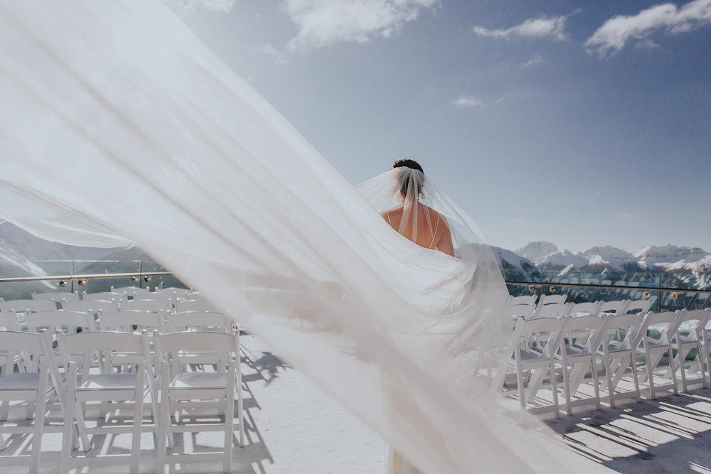 Bride with long veil, Sky bistro Banff wedding.jpg
