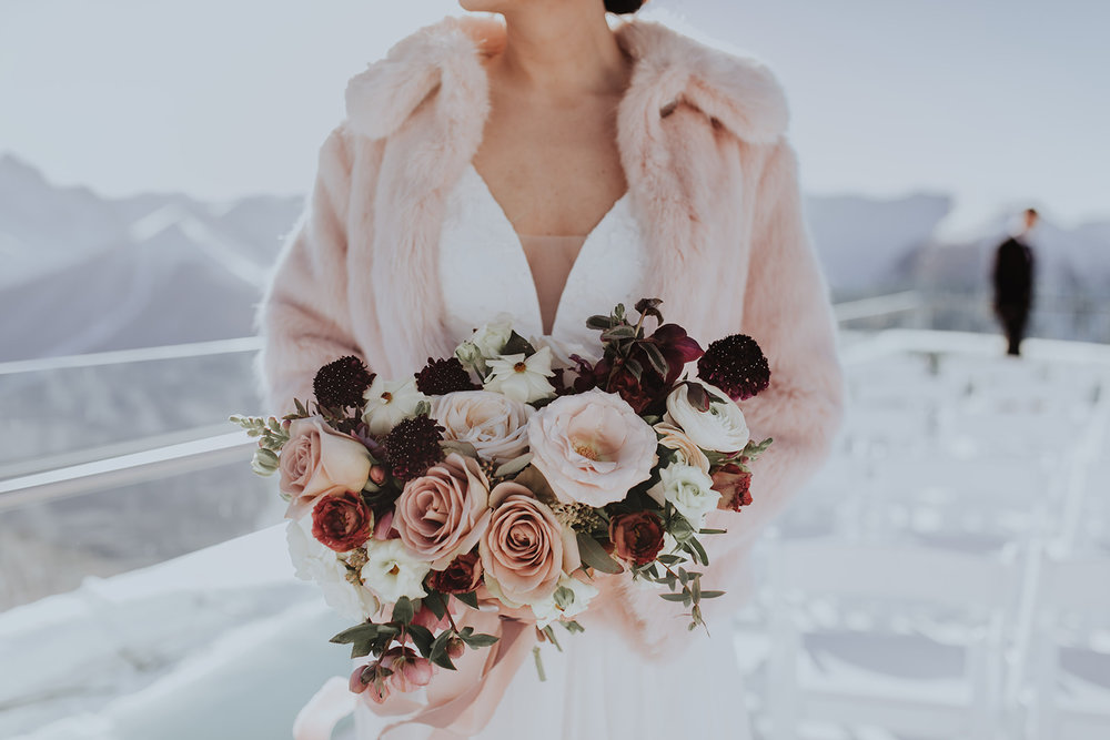 Winter bridal bouquet with Quicksand and amnesia roses, Sky bistro banff wedding, Flowers by Janie.jpg