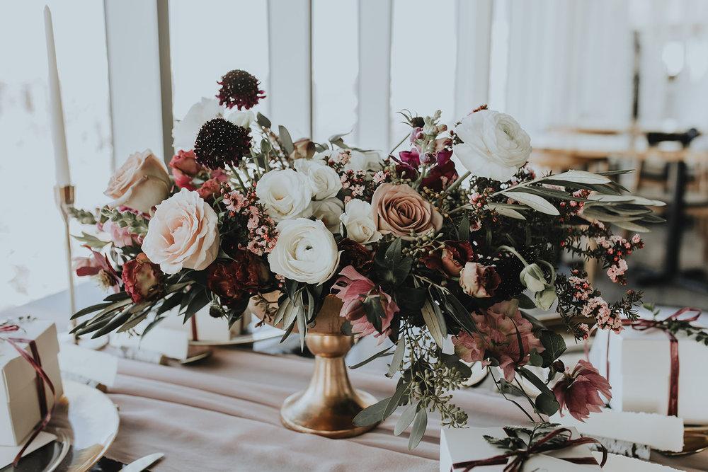 Wedding centerpiece at Sky Bistro Banff Gondola, Flowers by Janie.jpg