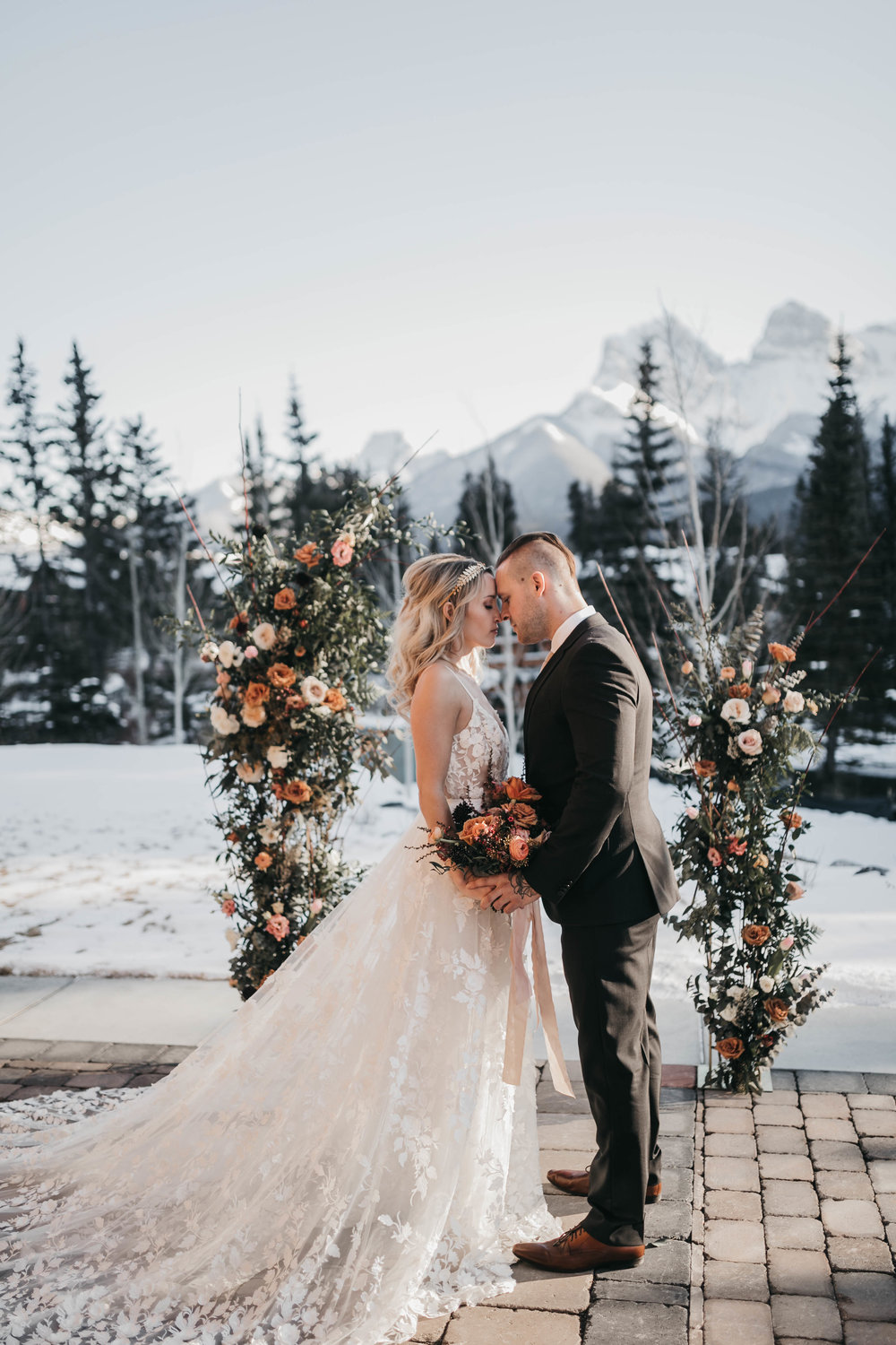 Outdoor wedding ceremony archway with bride and groom in Canmore, Flowers by Janie, Malcolm Hotel.jpg