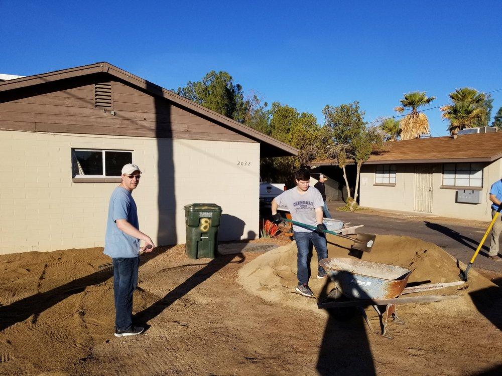 Brett and Nicholas building a parking area
