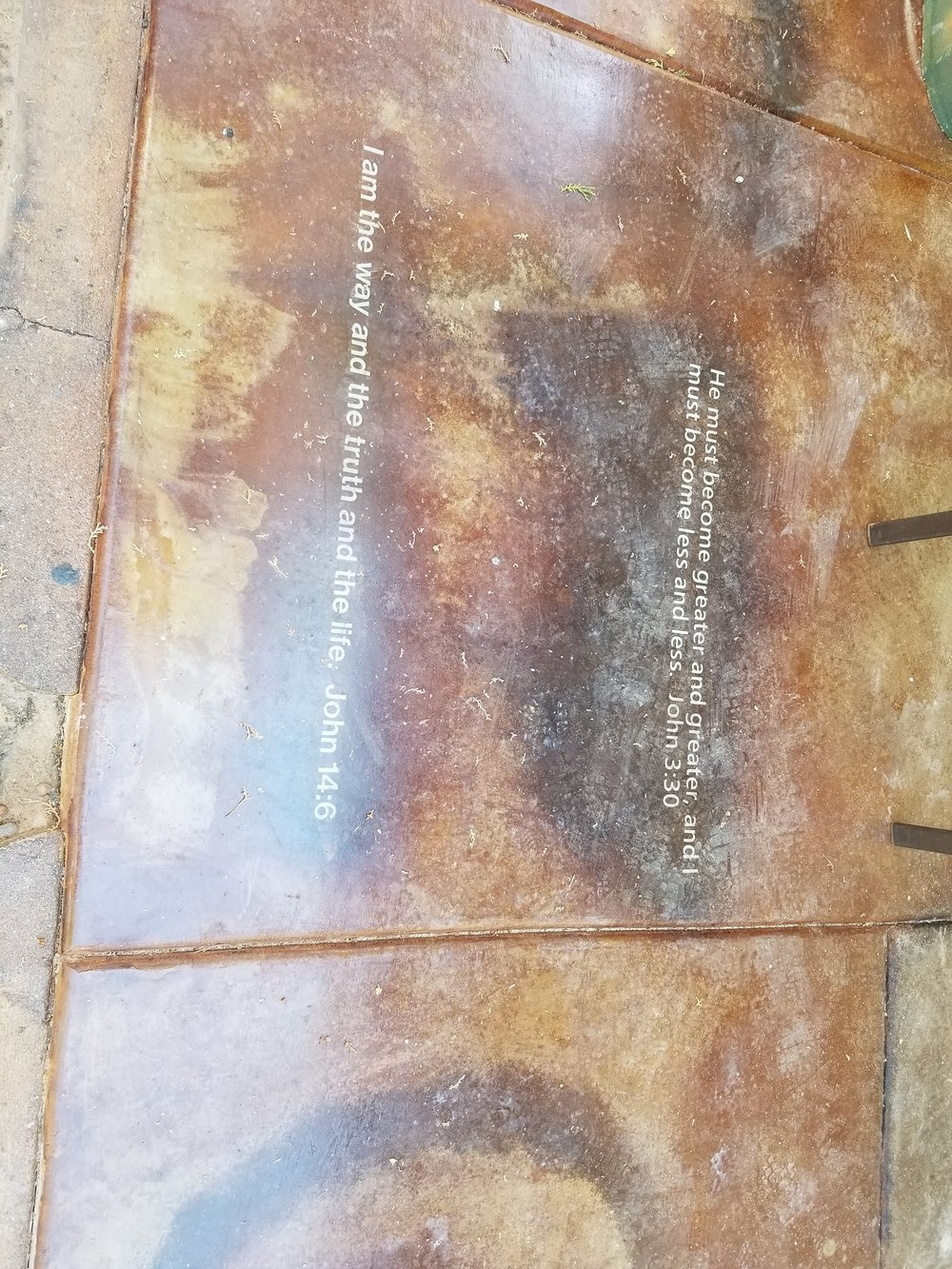 We acid stained scripture into the concrete of the patio and the bedroom floors.
