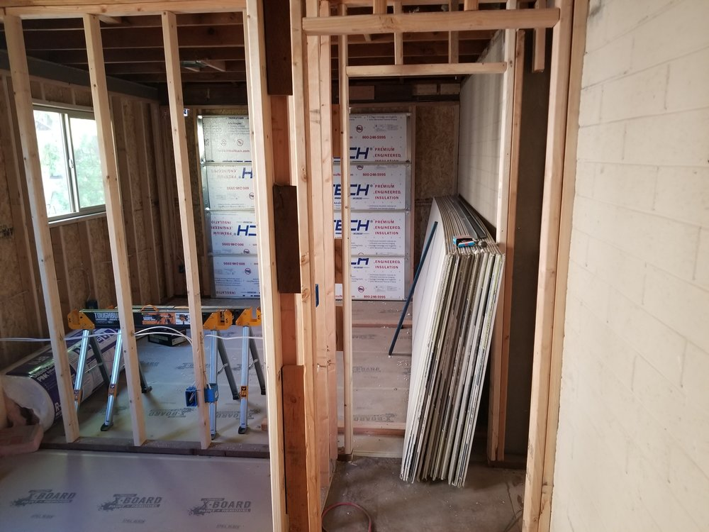 Electric in, insulation next, then drywall