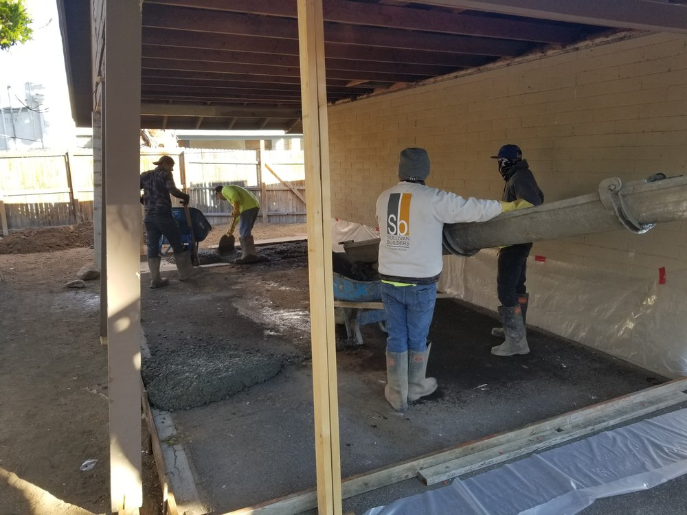 Sullivan Builders pouring concrete for two new bedrooms