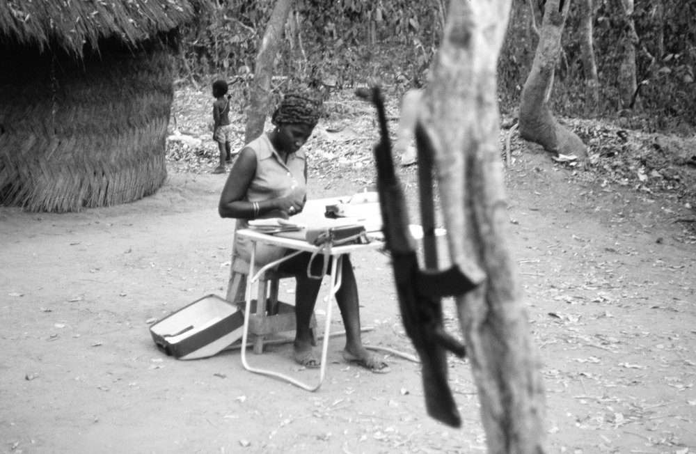 6a. Teodora at her typewriter at her base.jpg