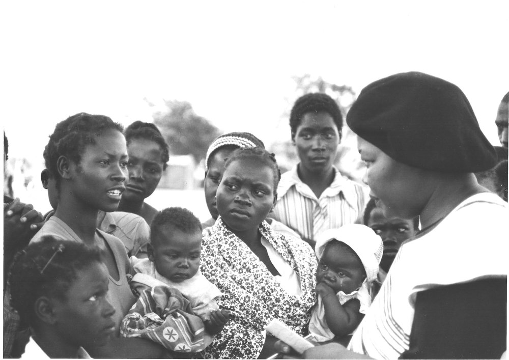 Lina Magaia, Mozambican journalist, peace activist, talking with a group of refugees in Tete who fled the conflict that South Africa supported through Renamo.