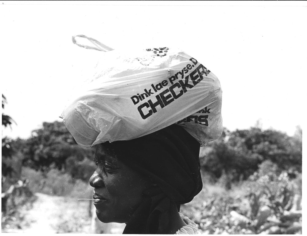 CHECKERS: THINK LOWER PRICES: Signs of South Africa in Três de Fevereiro Communal village: Men who worked in the South African mines sent remittances, so their families were better off than those who didn't. This is a shopping back from a large supermarket chain.