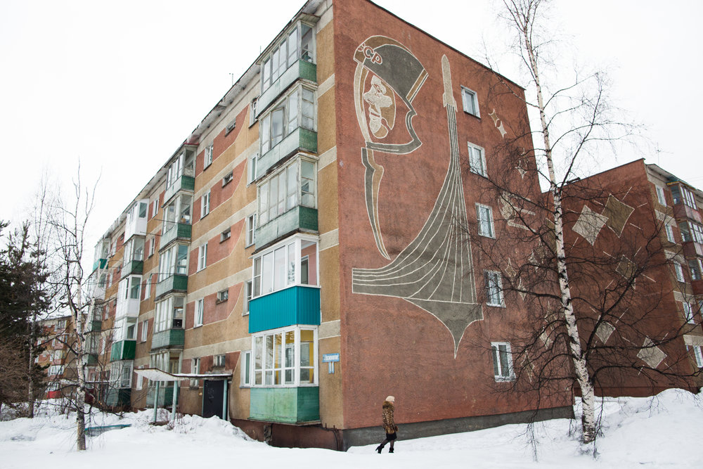 Soviet remnants on the side of an apartment block in Milkovo, Kamchatka. Photo: Karim Iliya.