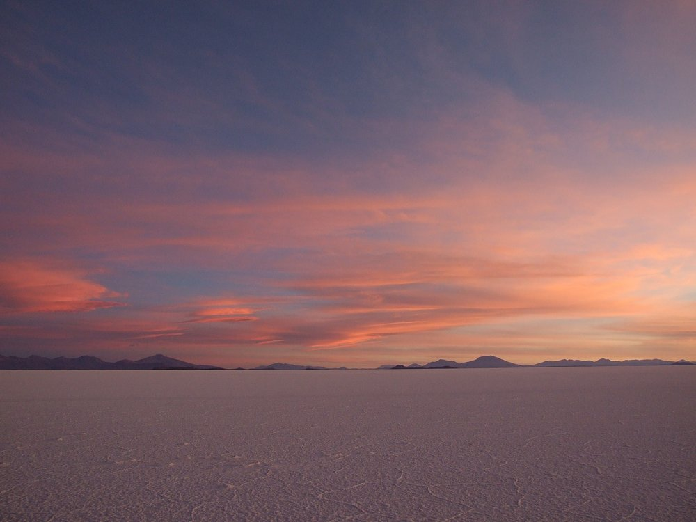 Sunset over Salar de Uyuni-- the Uyuni Salt Flats in Bolivia.