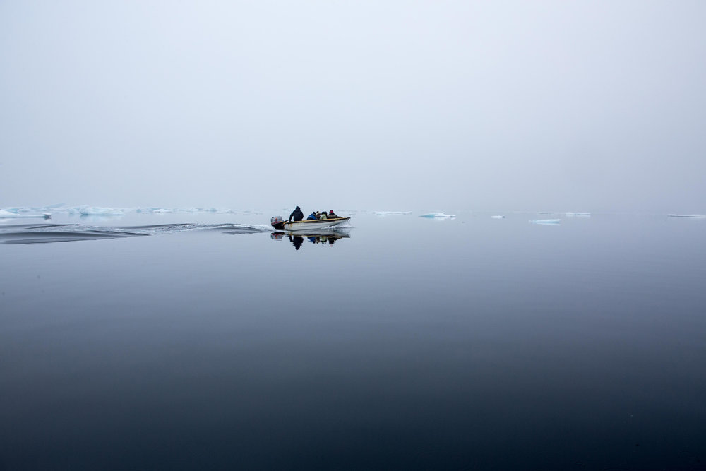 A local dingy transports people from Kulusuk to Kuummiit in Eastern Greenland.