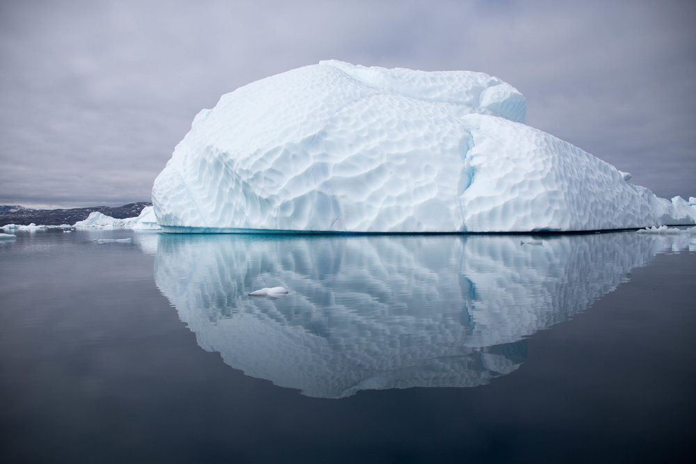 An unusually shaped iceberg floats by in the Tinit Ice Fjord.