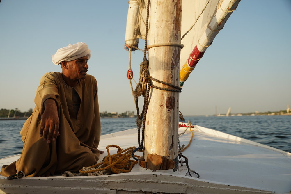 A local sails a fellucca on the Nile River in Luxor.