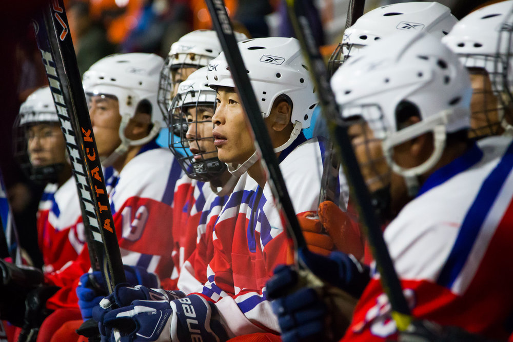 north-korean-mens-hockey-team-on-bench.jpg