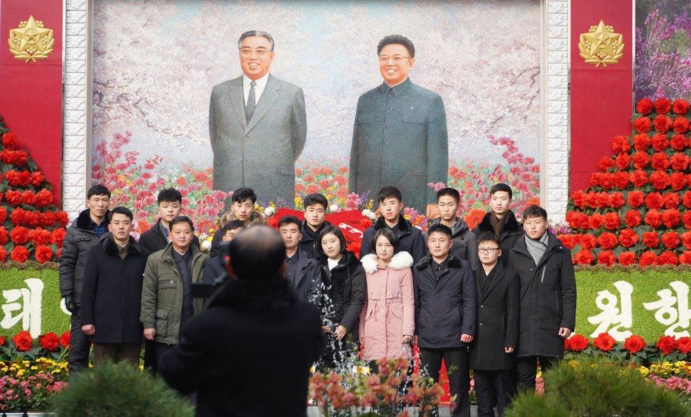 kimjongilia-exhibit-with-family-posing.jpg