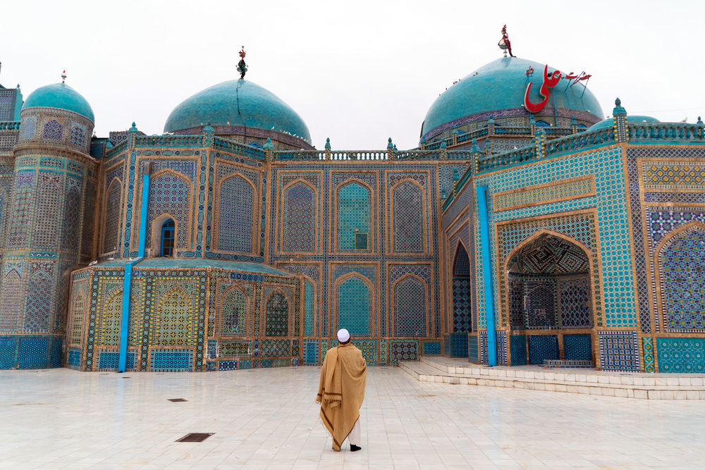 A man looks on with awe just after sunrise at the Blue Mosque in Mazarr-i Sharif.