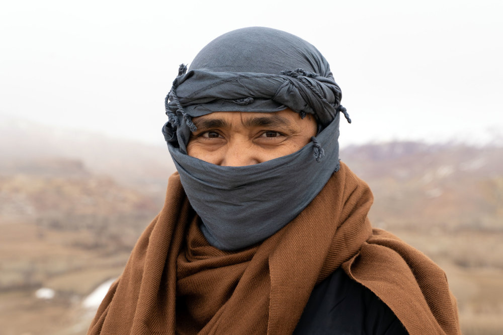 A portrait of our friend and partner Noor Mohammed in Bamyan. He's one of our favourite people in the world and his story and vision are inspiring. Here he's wearing a  patu  (blanket) and head scarf to stay warm in the strong winds of Bamyan Province.