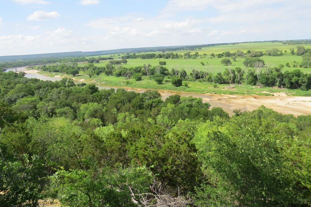 Brazos River 17.07+/- Acre Ranch, Spectacular Views - Quiet solitude amid towering trees on the beautiful Brazos River, ascending 150 feet to One of a Kind Build Site overlooking Magic Valley Ranch.Learn More →