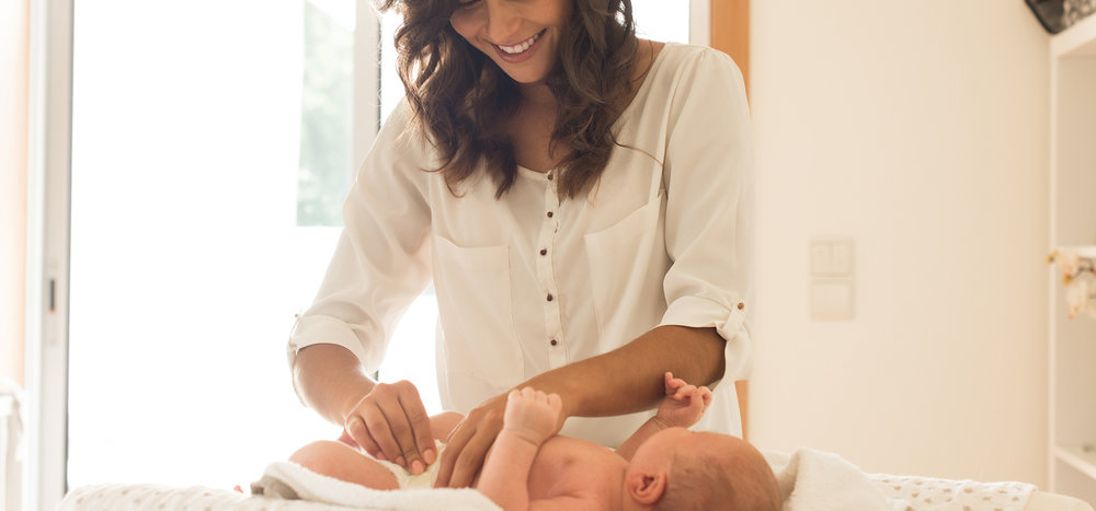 Women-changing-baby-diaper.jpg