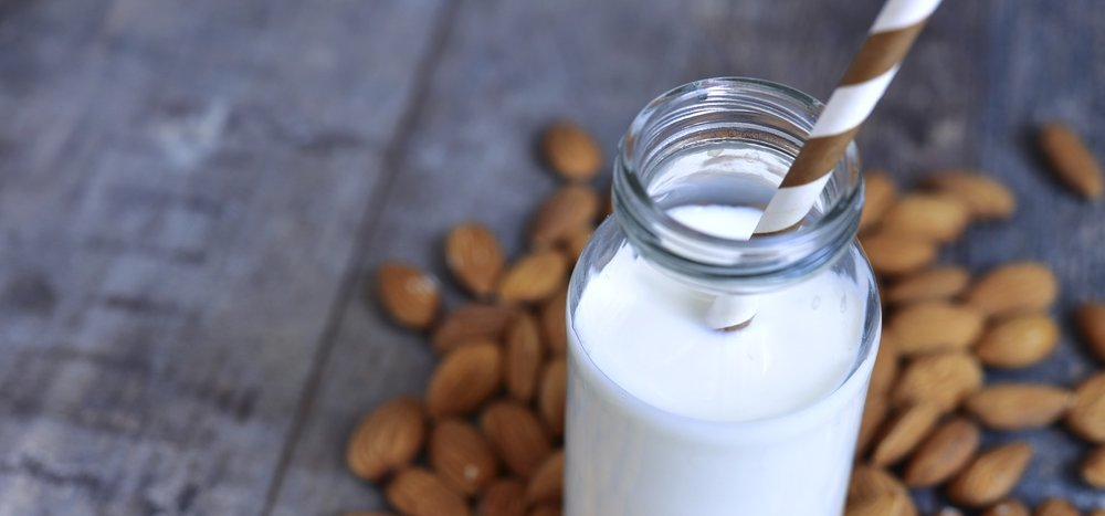 almond-milk-in-jar-with-almonds-on-table.jpg