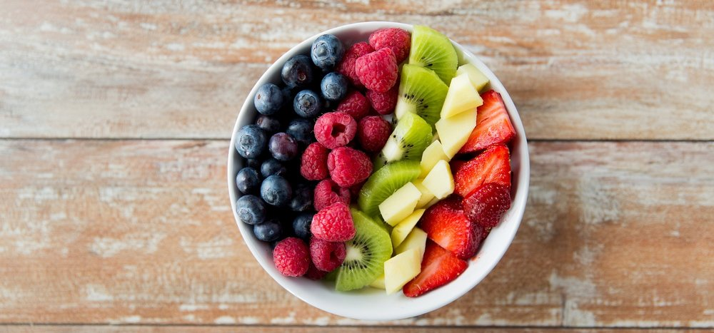 bowl-of-berries-and-kiwi-on-wooden-table.jpg