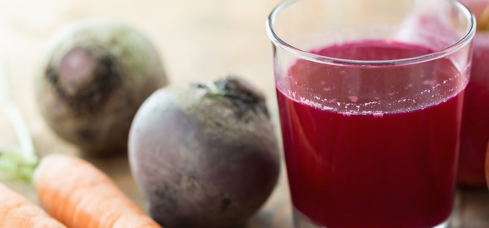 Glass of fresh beetroot, apple and carrot juice.jpg