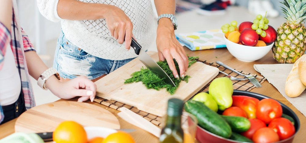Women-preparing-serving-dinner-in-a-kitchen-concept-cooking.jpg