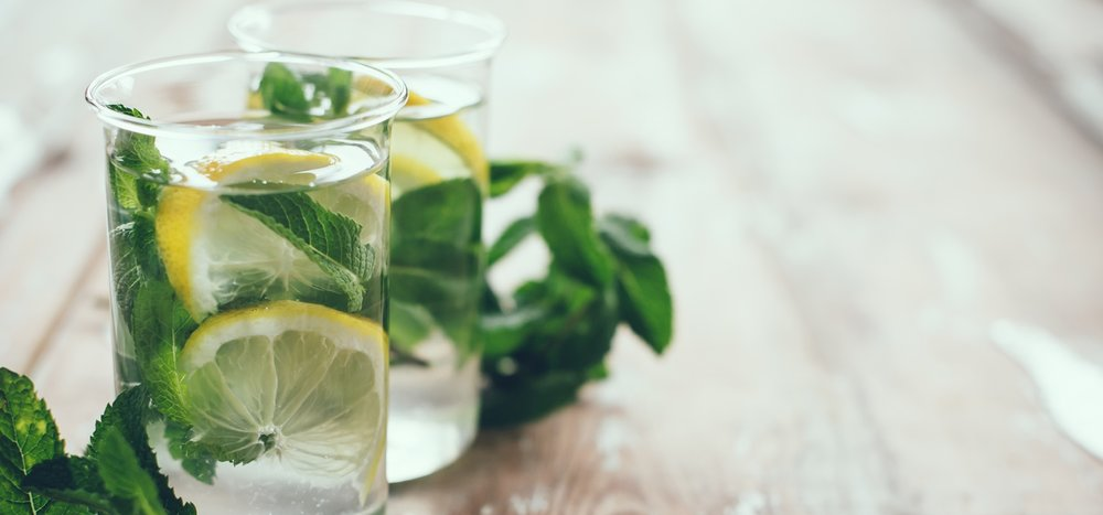 lemon-herbs-water-in-glass-to-promote-eating-healthy.jpg