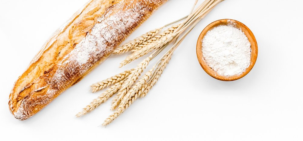 unhealthy-grains-wheat-bread-white-flour-on-table.jpg